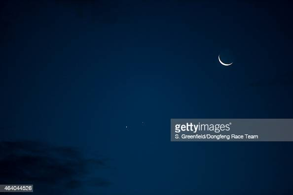 In this handout image provided by the Volvo Ocean Race onboard Dongfeng Race Team Crescent moon and Venus and Mars just after sunset during Leg 4...