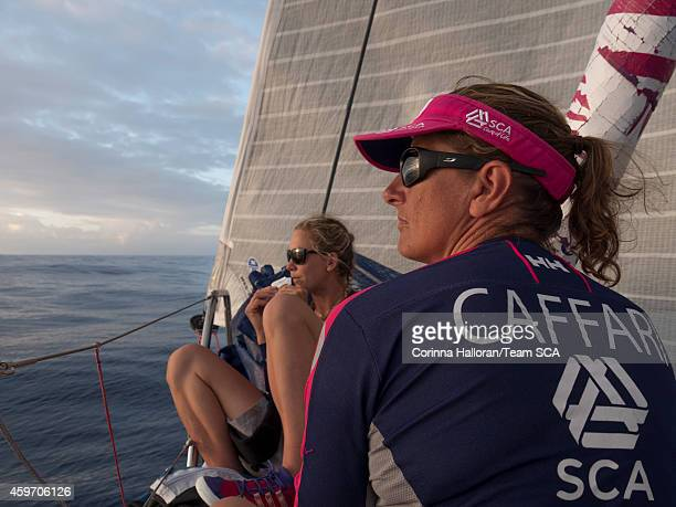 In this handout image provided by the Volvo Ocean Race onboard Team SCA Dee Caffari and Sophie Ciszek take a moment to enjoy the sunset during Leg 2...