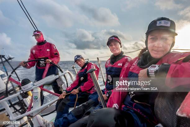 In this handout image provided by the Volvo Ocean Race onboard Team SCA Sophie Ciszek Justine Mettraux Carolijn Brouwer and Dee Caffarri on deck...