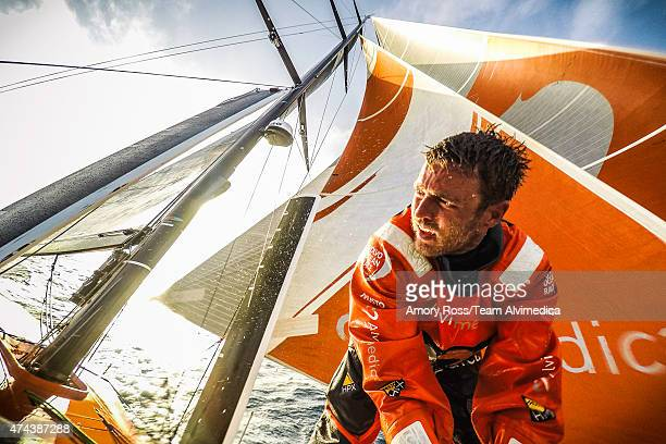 In this handout image provided by the Volvo Ocean Race onboard Team Alvimedica Nick Dana tidying up the foredeck after a lateafternoon sail change...