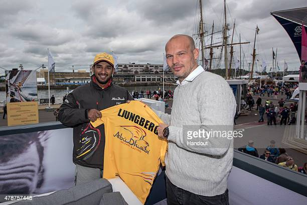 In this handout image provided by the Volvo Ocean Race Swedish Footballer Fredrik Ljungberg with Abu Dhabi Ocean Racing's crew member Adil Khalid...