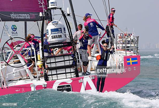 In this handout image provided by the Volvo Ocean Race Team SCA Ambassador and onboard guest Chinese Olympic Gold Medallist Lijia Xu jumps off the...