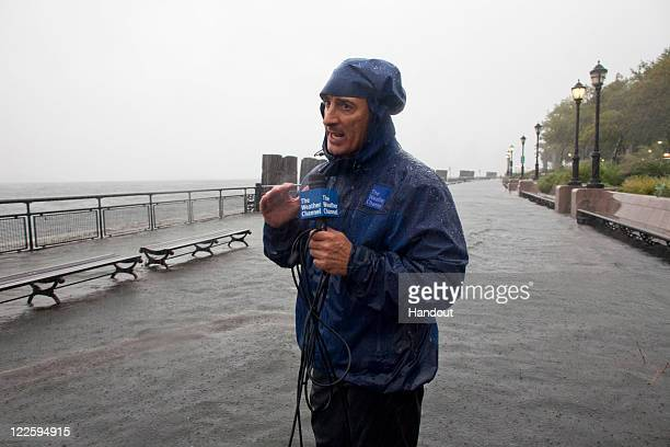 In this handout image provided by The Weather Channel Jim Cantore an oncamera meteorologist for The Weather Channel reports on Hurricane Irene from...
