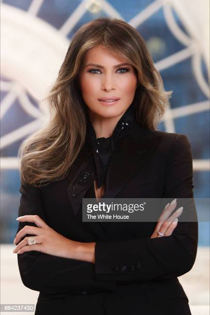 In this handout image provided by the White House First Lady Melania Trump poses for her official portrait in her residence at the White House April...