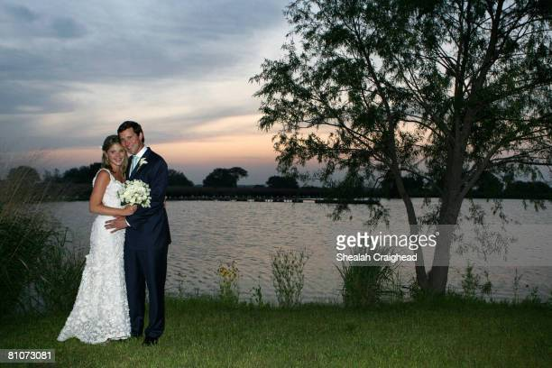 In this handout image provided by the White House Henry and Jenna Hager pose for photographs along the lake at Prairie Chapel Ranch following their...