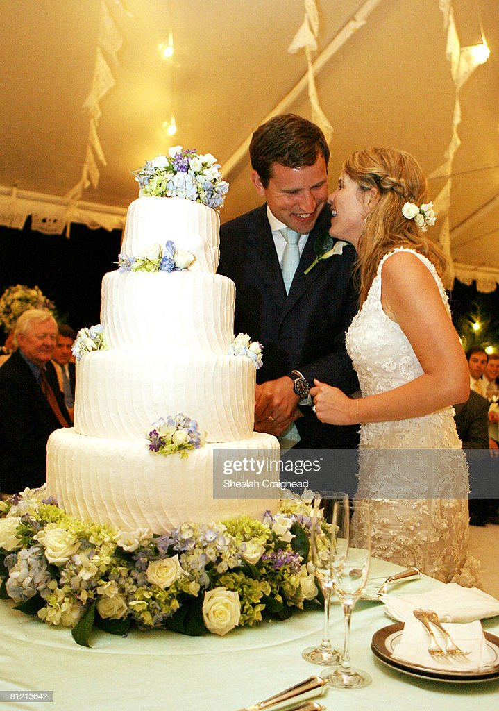 In this handout image provided by the White House, Henry and Jenna Hager pause as they cut their wedding cake during a reception in their honor following the ceremony at Prairie Chapel Ranch May 10, 2008 near Crawford, Texas.