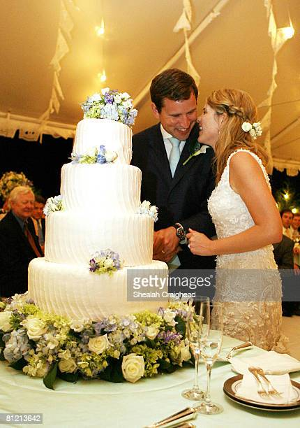 In this handout image provided by the White House Henry and Jenna Hager pause as they cut their wedding cake during a reception in their honor...