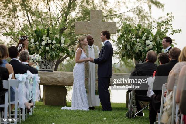 In this handout image provided by the White House Henry Hager and Jenna Bush exchange vows at the altar at Prairie Chapel Ranch as Rev Kirbyjohn...
