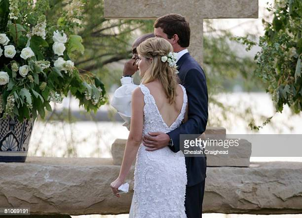 In this handout image provided by the White House Jenna Bush and Henry Hager stand at the altar listening to a reader with the Reverend Kirbyjohn...