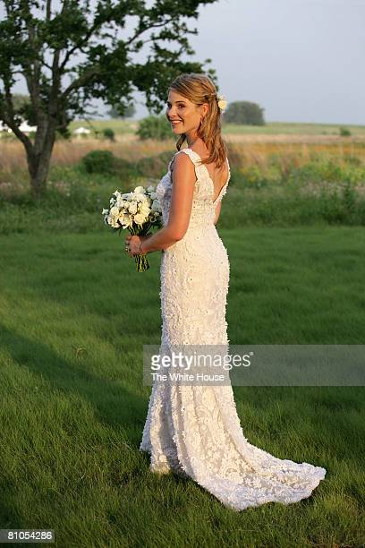 In this handout image provided by the White House Jenna Bush poses for a photographer prior to her wedding to Henry Hager at Prairie Chapel Ranch May...