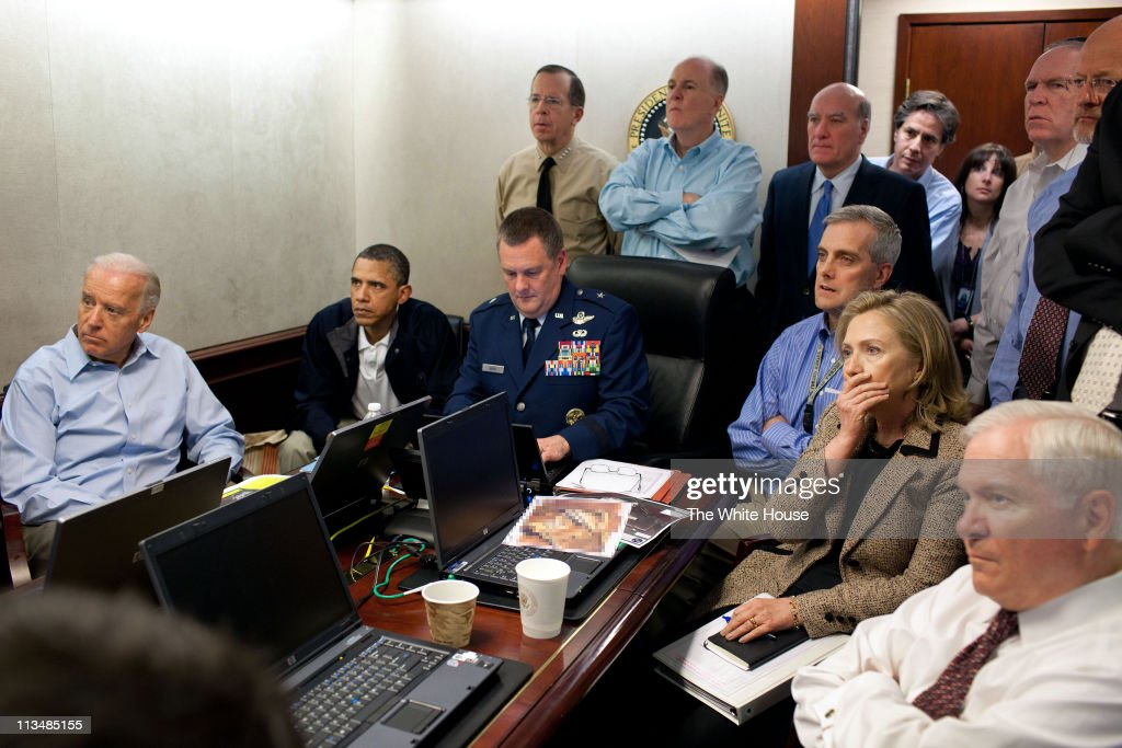 In this handout image provided by The White House, President Barack Obama, Vice President Joe Biden, Secretary of State <a gi-track='captionPersonalityLinkClicked' href=/galleries/search?phrase=Hillary+Clinton&family=editorial&specificpeople=76480 ng-click='$event.stopPropagation()'>Hillary Clinton</a> and members of the national security team receive an update on the mission against Osama bin Laden in the Situation Room of the White House May 1, 2011 in Washington, DC. Obama later announced that the United States had killed Bin Laden in an operation led by U.S. Special Forces at a compound in Abbottabad, Pakistan.