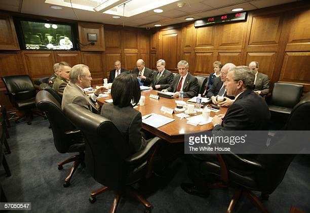 In this handout image provided by the White House the US President George W Bush meets with his National Security team in the White House Situation...