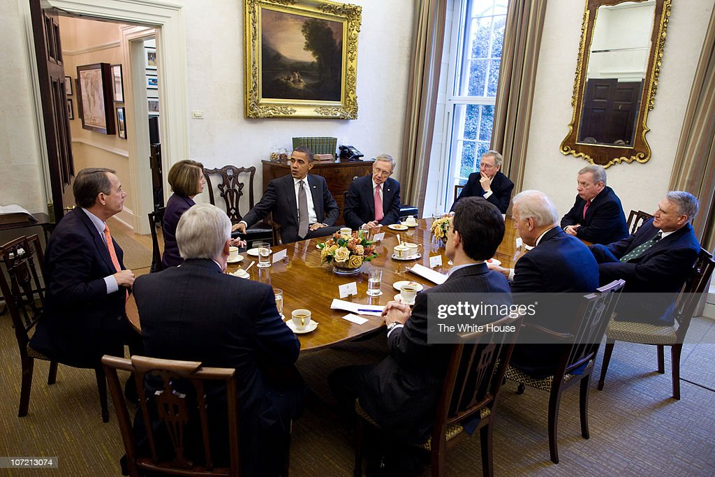 In this handout image provided by the White House US President Barack Obama and Vice President Joe Biden meet with bipartisan Congressional...
