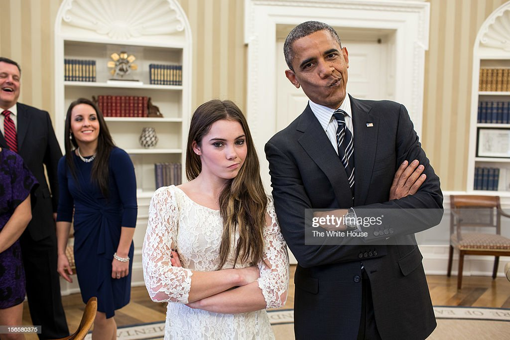 In this handout image provided by The White House, U.S. President Barack Obama jokingly mimics U.S. Olympic gymnast McKayla Maroney's 'not impressed' expression while greeting members of the 2012 U.S. Olympic gymnastics teams in the Oval Office November 15, 2012 at the White House in Washington, DC. Maroney's expression became an internet sensation when during the ceremony for her 2012 Olympic vault silver medal she was photographed giving a brief look of disappointment with her lips pursed to the side. Steve Penny, USA Gymnastics President, and Savannah Vinsant laugh at left.