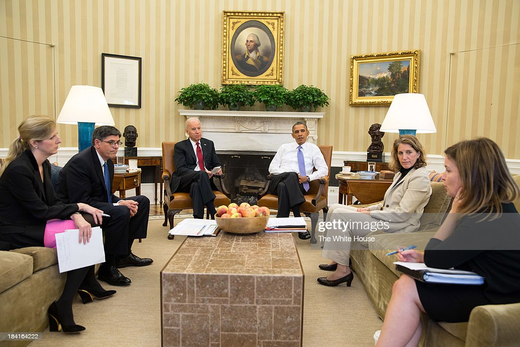 In this handout image provided by the White House, U.S. President <a gi-track='captionPersonalityLinkClicked' href=/galleries/search?phrase=Barack+Obama&family=editorial&specificpeople=203260 ng-click='$event.stopPropagation()'>Barack Obama</a> (3R) and Vice President Joe Biden (3L) listen as they are updated on the federal government shutdown and the approaching debt ceiling deadline by (L-R) Kathryn Ruemmler, Counsel to the President, Treasury Secretary <a gi-track='captionPersonalityLinkClicked' href=/galleries/search?phrase=Jack+Lew&family=editorial&specificpeople=2745013 ng-click='$event.stopPropagation()'>Jack Lew</a>, Sylvia Mathews Burwell, Director of OMB, and Alyssa Mastromonaco, Deputy Chief of Staff, in the Oval Office October 1, 2013 in Washington, DC. House Republicans and Senate Democrats continue to volley legislation back and forth as they battle over a budget to keep the government running and delaying or defunding 'Obamacare.'