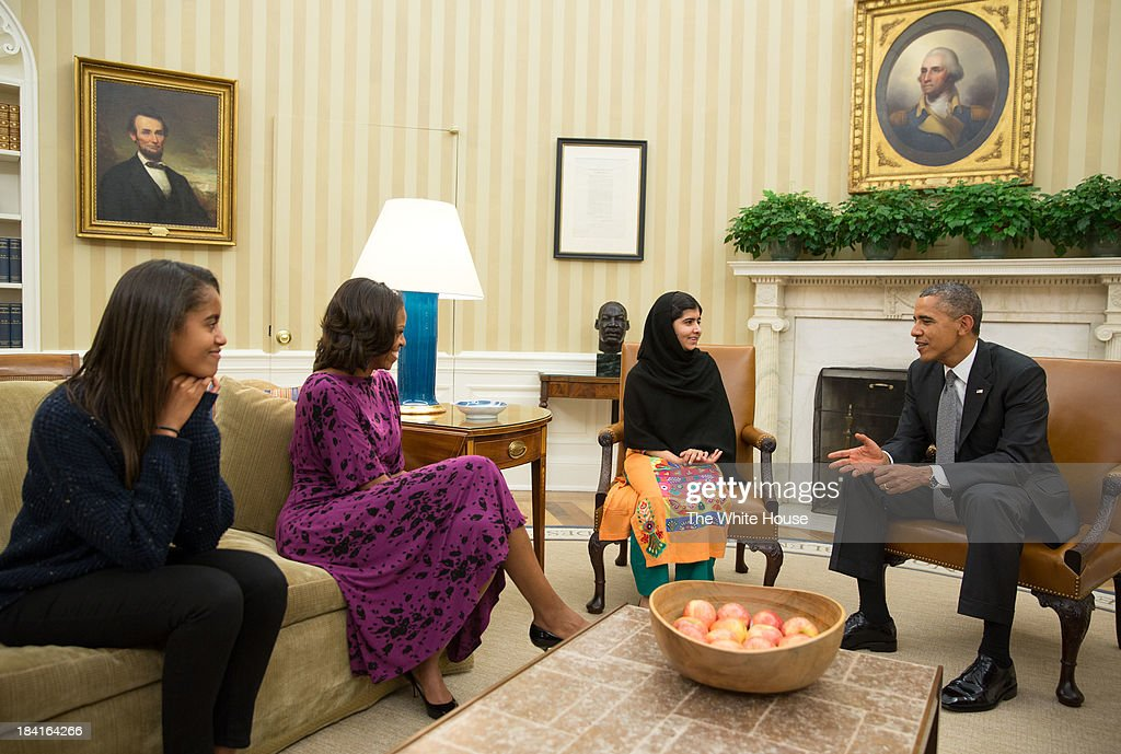 In this handout image provided by the White House, U.S. President <a gi-track='captionPersonalityLinkClicked' href=/galleries/search?phrase=Barack+Obama&family=editorial&specificpeople=203260 ng-click='$event.stopPropagation()'>Barack Obama</a> (R), first lady <a gi-track='captionPersonalityLinkClicked' href=/galleries/search?phrase=Michelle+Obama&family=editorial&specificpeople=2528864 ng-click='$event.stopPropagation()'>Michelle Obama</a> (2L), and their daughter <a gi-track='captionPersonalityLinkClicked' href=/galleries/search?phrase=Malia+Obama&family=editorial&specificpeople=2631620 ng-click='$event.stopPropagation()'>Malia Obama</a> (L) meet with <a gi-track='captionPersonalityLinkClicked' href=/galleries/search?phrase=Malala+Yousafzai&family=editorial&specificpeople=5849423 ng-click='$event.stopPropagation()'>Malala Yousafzai</a> in the Oval Office October 11, 2013 in Washington, DC. The Pakistani girl, 16, was shot in the head and neck in 2012 in Pakistan's Swat Valley by the Taliban for her activism for women's rights and education.