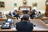 In this handout image provided by The White House US President Barack Obama talks with President Raúl Castro of Cuba from the Oval Office on December...