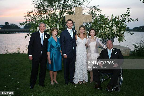 In this handout image provided by the White House US President George W Bush and Mrs Laura Bush and Mr and Mrs Hager pose with the newly married...