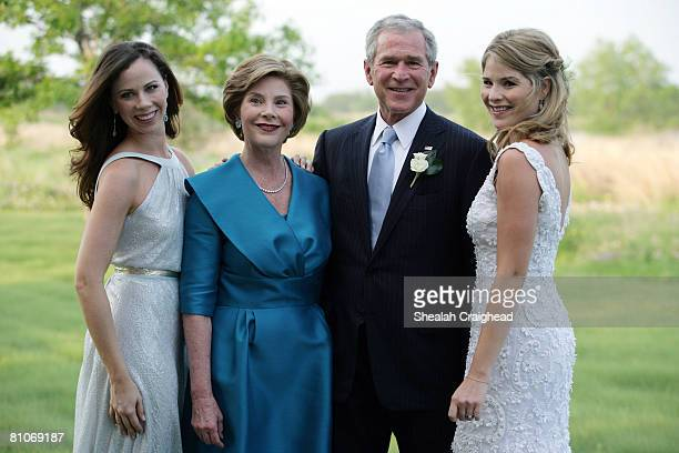 In this handout image provided by the White House US President George W Bush and Mrs Laura Bush pose with daughters Jenna and Barbara prior to the...