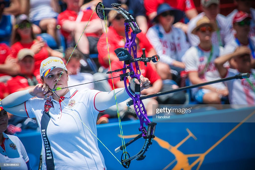 In this handout image provided by the World Archery Federation, Albina Loginova (RUS) shoots in the compound mixed team bronze medal match during the Hyundai Archery World Cup on April 30, 2016 in Shanghai , China.