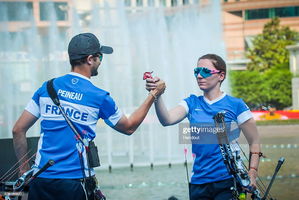 In this handout image provided by the World Archery Federation, Sebastien Peineau and Amelie Sancenot (FRA) celebrate winning in the compound mixed team gold medal match during the Hyundai Archery World Cup on April 30, 2016 in Shanghai , China.