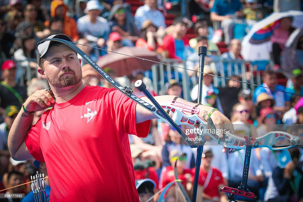 In this handout image provided by the World Archery Federation, Brady Ellison (USA) shoots in the recurve mixed team gold medal match during the Hyundai Archery World Cup on May 1, 2016 in Shanghai , China.