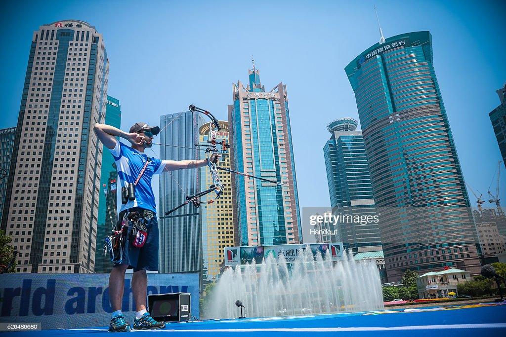 In this handout image provided by the World Archery Federation, Sebastien Peineau (FRA) shoots in the compound mixed team gold medal match during the Hyundai Archery World Cup on April 30, 2016 in Shanghai , China.