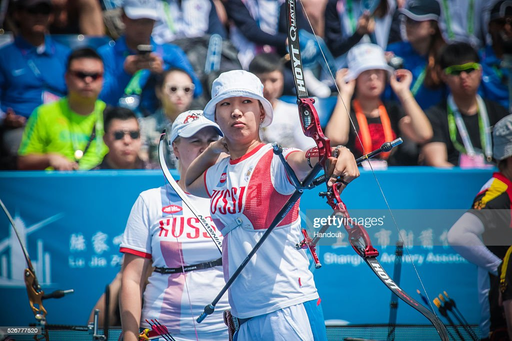 In this handout image provided by the World Archery Federation, Inna Stepanova (RUS) shoots in the recurve women team bronze medal match during the Hyundai Archery World Cup on May 1, 2016 in Shanghai , China.