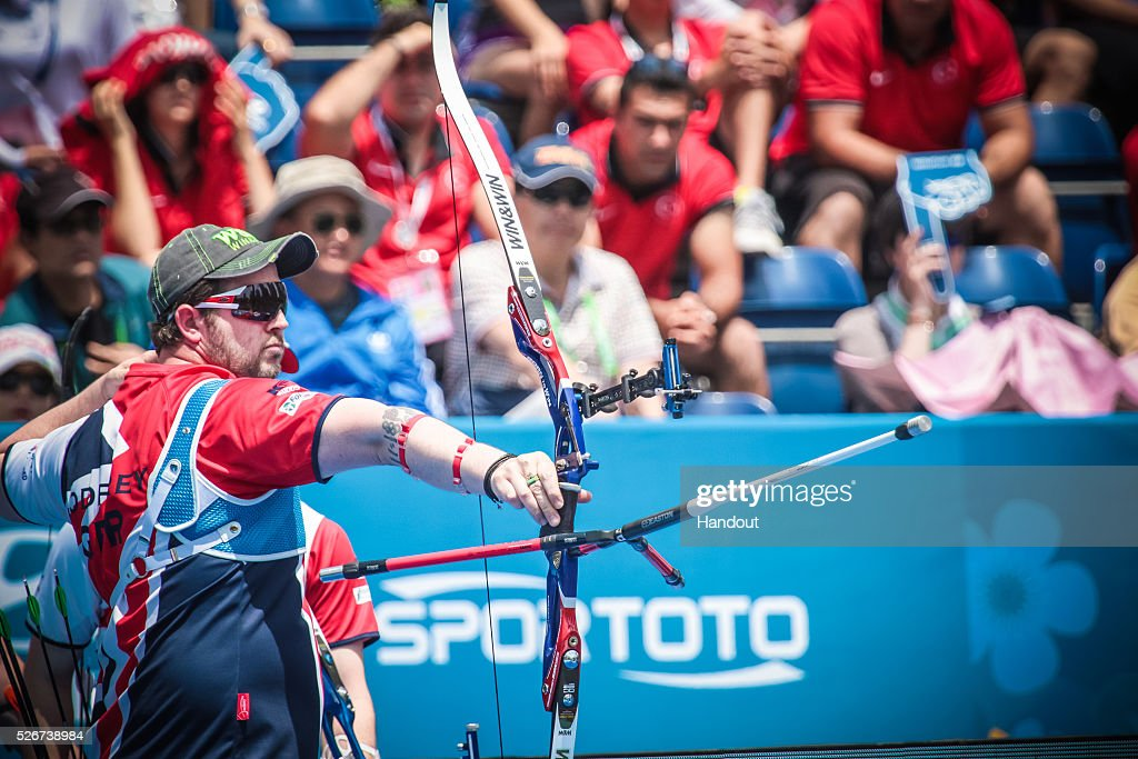 In this handout image provided by the World Archery Federation, Larry Godfrey of Great Britain shoots in the recurve men team bronze medal match during the Hyundai Archery World Cup on May 1, 2016 in Shanghai , China.