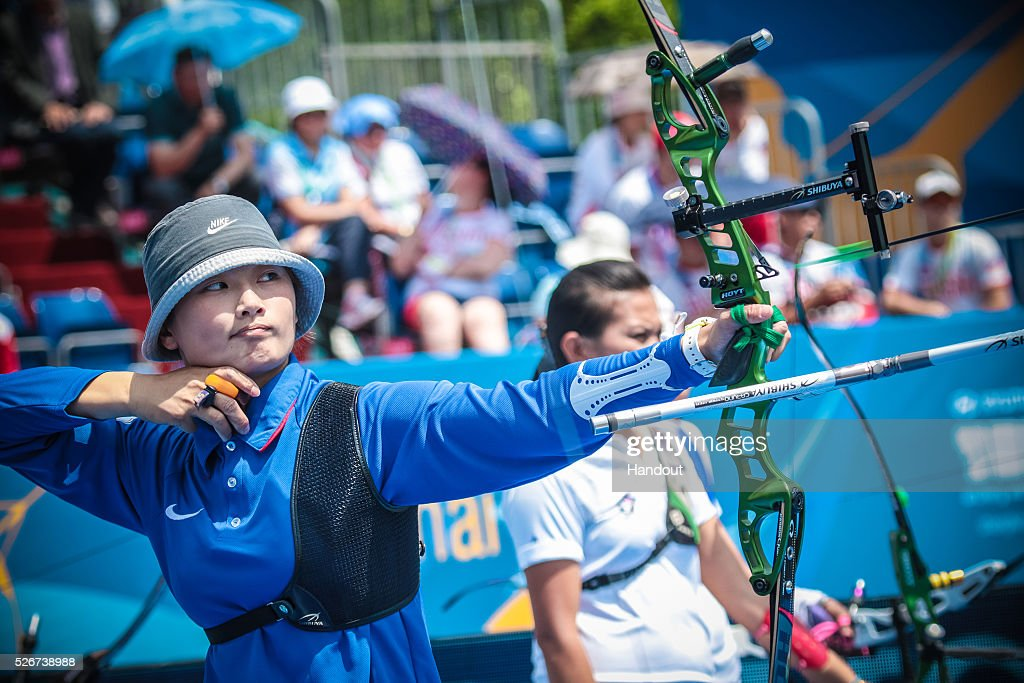 In this handout image provided by the World Archery Federation, Lin Shih-Chia (TPE) shoots in the recurve women team gold medal match during the Hyundai Archery World Cup on May 1, 2016 in Shanghai , China.