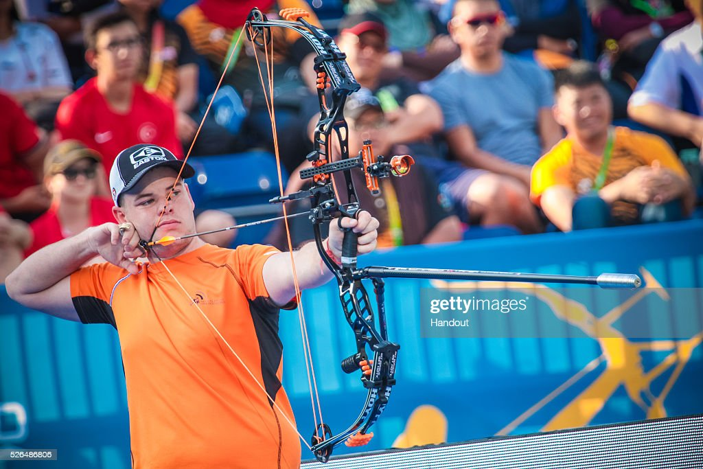 In this handout image provided by the World Archery Federation, Mike Schloesser (NED) shoots in the compound men gold medal match during the Hyundai Archery World Cup on April 30, 2016 in Shanghai , China.
