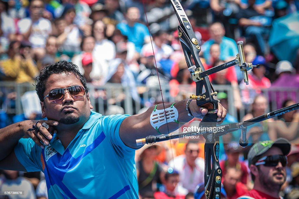 In this handout image provided by the World Archery Federation, Jayanta Talukdar of India shoots in the recurve men team bronze medal match during the Hyundai Archery World Cup on May 1, 2016 in Shanghai , China.