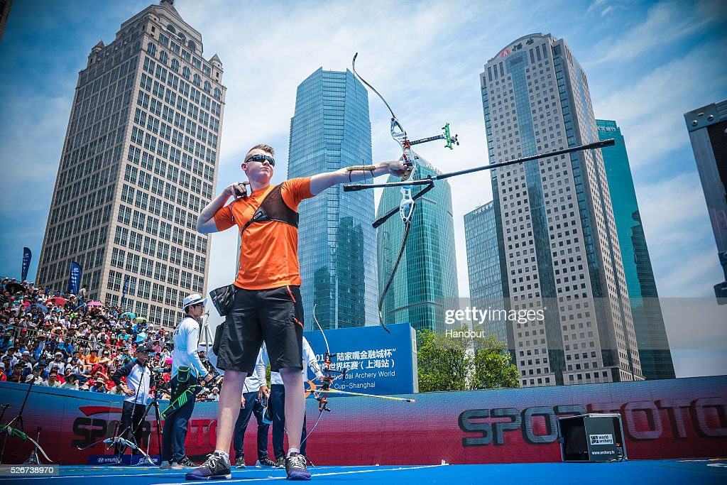 In this handout image provided by the World Archery Federation, Sjef van den Berg of the Netherlands shoots in the recurve men team gold medal match during the Hyundai Archery World Cup on May 1, 2016 in Shanghai , China.