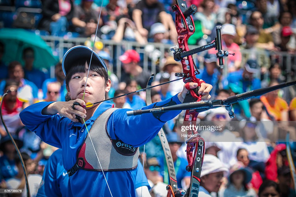 In this handout image provided by the World Archery Federation, Tan Ya-Ting (TPE) shoots in the recurve women team gold medal match during the Hyundai Archery World Cup on May 1, 2016 in Shanghai , China.