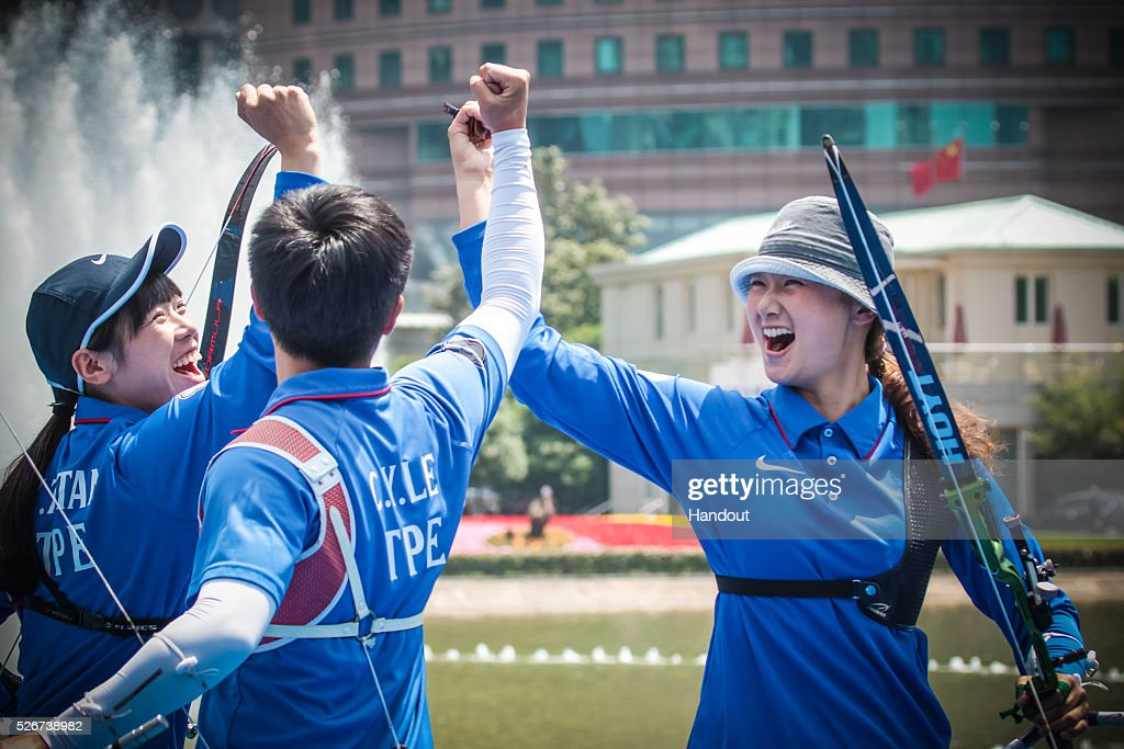 In this handout image provided by the World Archery Federation, Tan Ya-Ting, Le Chien-Ying and Lin Shih-Chia (TPE) celebrate the recurve women team gold medal during the Hyundai Archery World Cup on May 1, 2016 in Shanghai , China.