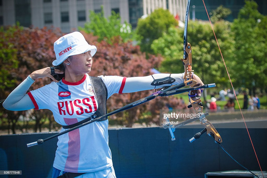 In this handout image provided by the World Archery Federation, Tuiana Dashidorzhieva (RUS) shoots in the recurve women team bronze medal match during the Hyundai Archery World Cup on May 1, 2016 in Shanghai , China.