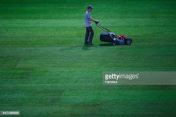 In this handout image provided by UEFA A groundsman cuts the grass as the pitch is replaced during the UEFA EURO 2016 at Stade Pierre Mauroy on June...