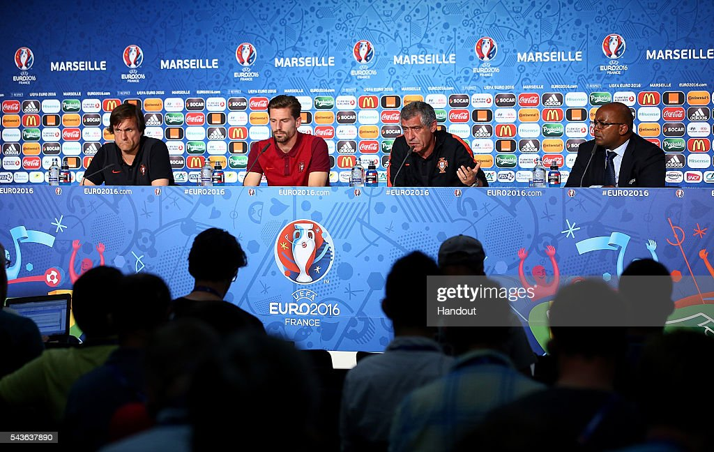 In this handout image provided by UEFA, <a gi-track='captionPersonalityLinkClicked' href=/galleries/search?phrase=Adrien+Silva&family=editorial&specificpeople=2202656 ng-click='$event.stopPropagation()'>Adrien Silva</a> and Portugal coach <a gi-track='captionPersonalityLinkClicked' href=/galleries/search?phrase=Fernando+Santos+-+Soccer+Coach&family=editorial&specificpeople=9459592 ng-click='$event.stopPropagation()'>Fernando Santos</a> face the media during the Portugal press conference at Stade Velodrome on June 29, 2016 in Marseille, France.