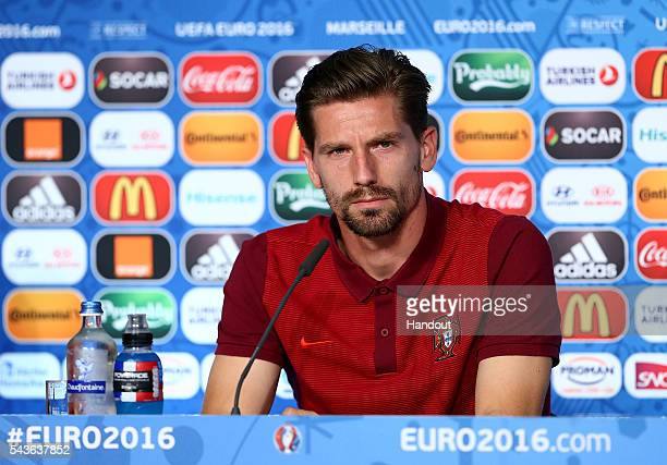 In this handout image provided by UEFA Adrien Silva faces the media during the Portugal press conference at Stade Velodrome on June 29 2016 in...