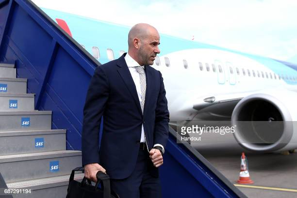 In this handout image provided by UEFA Ajax coach Peter Bosz arrives with his team ahead of the UEFA Europa League Final between Ajax and Manchester...