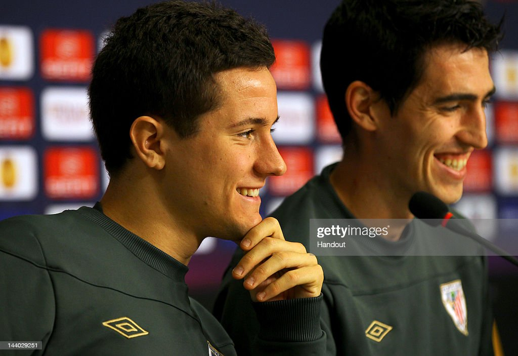 In this handout image provided by UEFA, <a gi-track='captionPersonalityLinkClicked' href=/galleries/search?phrase=Ander+Herrera&family=editorial&specificpeople=6331880 ng-click='$event.stopPropagation()'>Ander Herrera</a> (L) and <a gi-track='captionPersonalityLinkClicked' href=/galleries/search?phrase=Andoni+Iraola&family=editorial&specificpeople=625710 ng-click='$event.stopPropagation()'>Andoni Iraola</a> of Athletic Bilbao smile during the Athletic Bilbao press conference ahead of the UEFA Europa League Final between Atletico Madrid and Athletic Bilbao at the National Arena on May 8, 2012 in Bucharest, Romania.