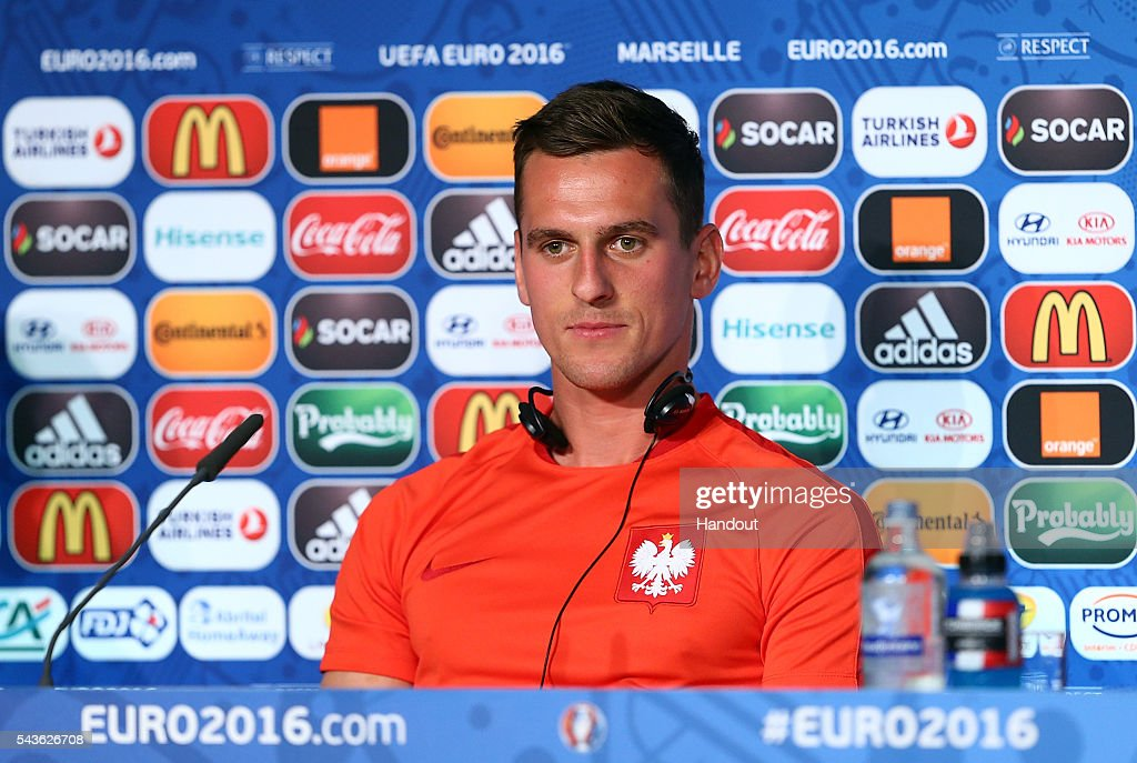 In this handout image provided by UEFA, <a gi-track='captionPersonalityLinkClicked' href=/galleries/search?phrase=Arkadiusz+Milik&family=editorial&specificpeople=9852666 ng-click='$event.stopPropagation()'>Arkadiusz Milik</a> faces the media during the Poland press conference at Stade Velodrome on June 29, 2016 in Marseille, France.
