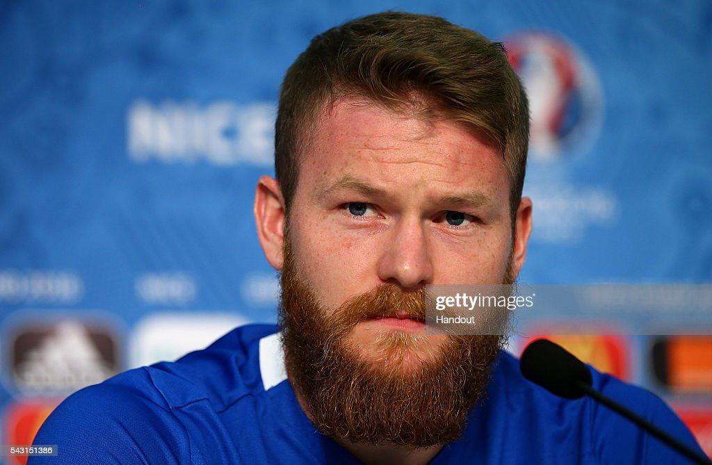 In this handout image provided by UEFA, Aron Gunnarsson faces the media during the Iceland press conference at Allianz Riviera Stadium on June 26, 2016 in Nice, France.
