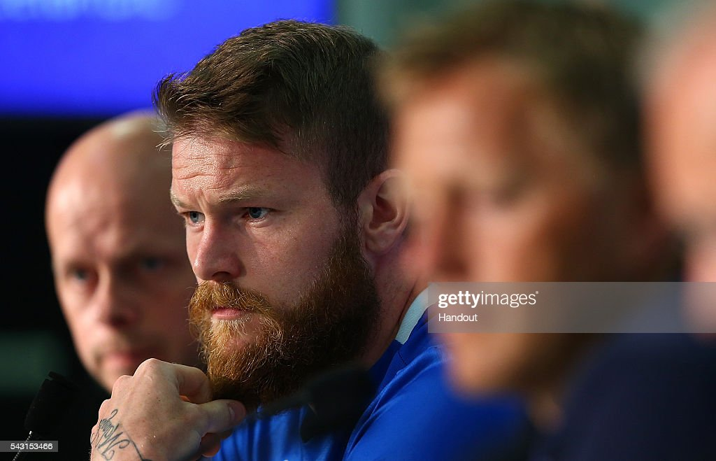 In this handout image provided by UEFA, <a gi-track='captionPersonalityLinkClicked' href=/galleries/search?phrase=Aron+Gunnarsson&family=editorial&specificpeople=5490377 ng-click='$event.stopPropagation()'>Aron Gunnarsson</a> faces the media during the Iceland press conference at Allianz Riviera Stadium on June 26, 2016 in Nice, France.