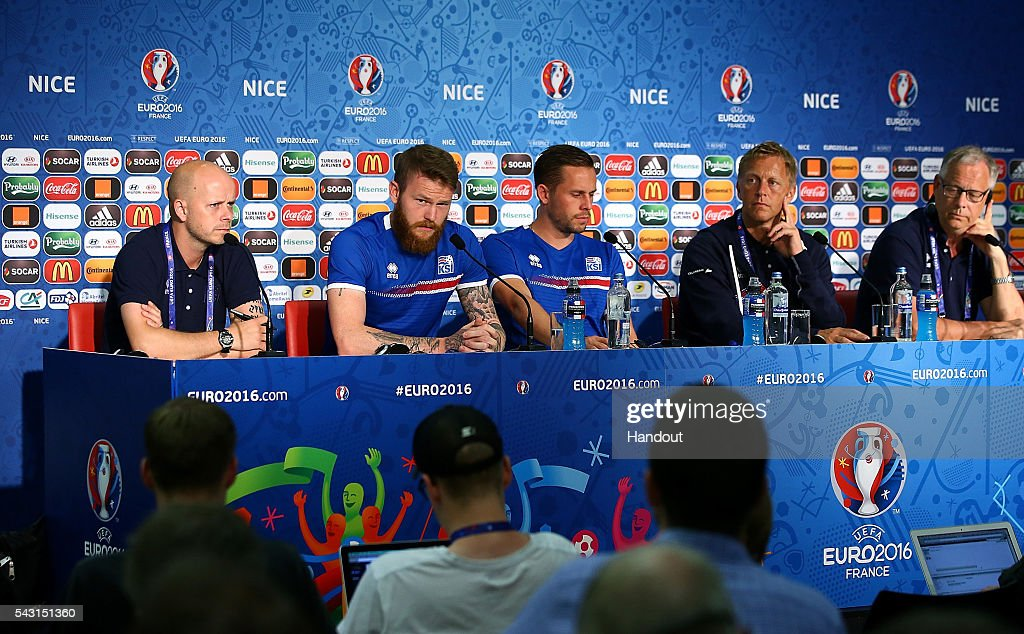 In this handout image provided by UEFA, (l-r) <a gi-track='captionPersonalityLinkClicked' href=/galleries/search?phrase=Aron+Gunnarsson&family=editorial&specificpeople=5490377 ng-click='$event.stopPropagation()'>Aron Gunnarsson</a>, <a gi-track='captionPersonalityLinkClicked' href=/galleries/search?phrase=Gylfi+Sigurdsson&family=editorial&specificpeople=6401581 ng-click='$event.stopPropagation()'>Gylfi Sigurdsson</a>, coaches, Heimir Hallgrimsson and <a gi-track='captionPersonalityLinkClicked' href=/galleries/search?phrase=Lars+Lagerback&family=editorial&specificpeople=542148 ng-click='$event.stopPropagation()'>Lars Lagerback</a> face the media during the Iceland press conference at Allianz Riviera Stadium on June 26, 2016 in Nice, France.