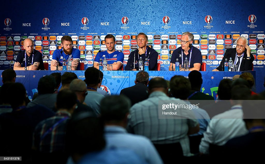 In this handout image provided by UEFA, (l-r) Aron Gunnarsson, Gylfi Sigurdsson, coaches, Heimir Hallgrimsson and Lars Lagerback face the media during the Iceland press conference at Allianz Riviera Stadium on June 26, 2016 in Nice, France.