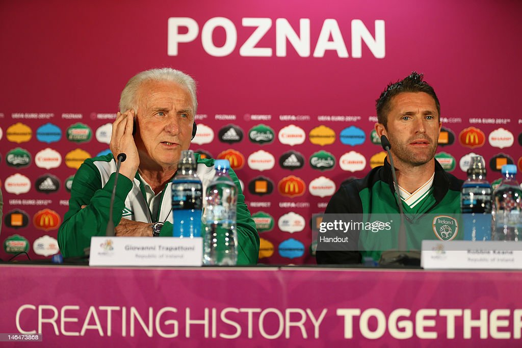 In this handout image provided by UEFA, Coach <a gi-track='captionPersonalityLinkClicked' href=/galleries/search?phrase=Giovanni+Trapattoni&family=editorial&specificpeople=209002 ng-click='$event.stopPropagation()'>Giovanni Trapattoni</a> and <a gi-track='captionPersonalityLinkClicked' href=/galleries/search?phrase=Robbie+Keane&family=editorial&specificpeople=171824 ng-click='$event.stopPropagation()'>Robbie Keane</a> of Republic of Ireland talk to the media during a UEFA EURO 2012 press conference ahead of the UEFA EURO 2012 Group C match between Italy and Republic of Ireland at the Municipal Stadium on June 17, 2012 in Poznan, Poland.