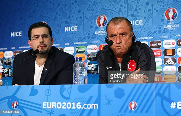 In this handout image provided by UEFA coach of Turkey Fatih Terim faces the media during the Turkey Press Conference at Allianz Riviera Stadium on...