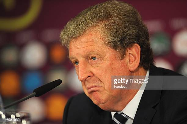 In this handout image provided by UEFA Coach Roy Hodgson of England talks to the media after the UEFA EURO 2012 Quarter Final match between England...