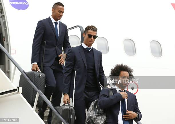 In this handout image provided by UEFA Cristiano Ronaldo and Marcelo of Real Madrid arrive prior to the UEFA Champions League Final between Juventus...